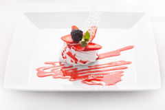 Mousse, cream, decorated with berries and jam Royalty Free Stock Images