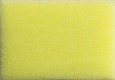 Mousse en plastique jaune d'éponge Photographie stock libre de droits