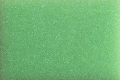 Mousse en plastique verte d'éponge Photographie stock libre de droits