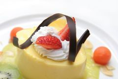 Mousse mango. Mango mousse dessert cake on white plate Stock Photography