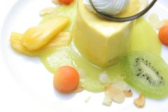 Mousse mango. Mango mousse dessert cake on white plate Stock Photography