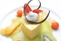 Mousse mango. Mango mousse dessert cake on white plate Stock Photos