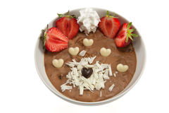 Mousse with strawberries and chocolate hearts. Picture of a dessert with strawberries, chocolate hearts and some cream Royalty Free Stock Photos