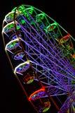 Moussera kulöra ljus, en enorm karusell Royaltyfria Bilder