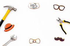 Moustache, hat, glasses, bow tie, tools and copy for Happy Father Day party on white background top view copy space. Moustache, hat, glasses, bow tie, set of stock photo