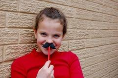Moustache sur un bâton Photos libres de droits