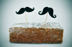 Moustaches in a cake Royalty Free Stock Images