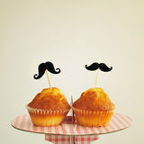 Moustaches in cupcakes, with a retro effect Stock Image