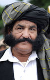 Moustaches. A face from a demonstration by Imran Khan royalty free stock photography