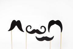 Moustaches on wooden sticks Stock Photography