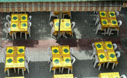 Moustiers-Sainte-Marie (France): brasserie. Moustiers-Ste-Marie (Alpes-de-Haute-Provence, Provence-Alpes-Cote d'Azur, France) - Tables of a brasserie Stock Photo