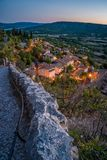 Moustiers Sainte Marie lighting up. Moustiers village lighting up in Provence, France Stock Photo