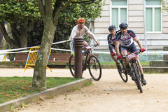 Moutain bike race. PONTEVEDRA, SPAIN - MARCH 29, 2015: Participants in a mountain bike race, Route 2nd BTT Cidade de Pontevedra, in the time they arrive at the Stock Photos