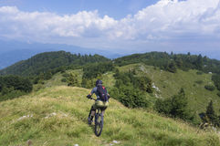 Moutain biker descending from Mozic hill Royalty Free Stock Photography