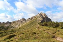 Moutain and footpath. Moutain panorama with Lachenspitze and footpath Stock Photo