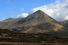 Moutain on the Isle of Skye. Clouds passing over a mountain on the Isle of Skye, Scotland Royalty Free Stock Photography