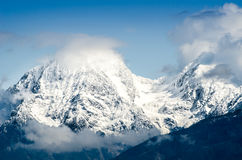Moutain pass in the Alps with snow and clouds Stock Photo