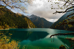 Moutains and Lakes in Jiuzhaigou Valley. Rivers and Lakes in Jiuzhaigou Valley with Cloudy sky Royalty Free Stock Photography