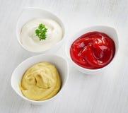 Moutarde, ketchup et mayonnaise Image libre de droits