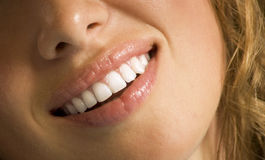 Mouth care. Close-up of happy female healthy teeth shown in smile Stock Image