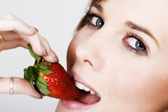 Mouth with fresh strawberry Stock Photos