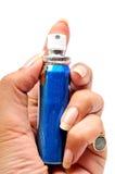 Mouth freshener spray. Female hand holding mouth freshener spray over white background royalty free stock images