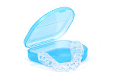 Mouth guard. Clear plastic teeth guard and case on white royalty free stock photography