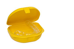 Mouth guard in its container. Isolated in white Royalty Free Stock Image