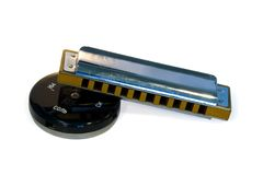 Mouth harmonica and round tuner Royalty Free Stock Image