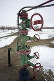 The mouth of the oil wells on the valve and pump. Oil production. Stock Photography