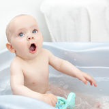 Mouth open.bis. Wet baby in a blue bathtub Royalty Free Stock Photography