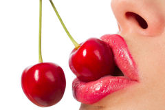 Mouth with red cherries. Female mouth with two red cherries Royalty Free Stock Image