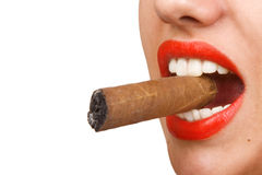 Mouth with red lips biting a cigar Royalty Free Stock Photo