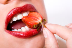 Mouth with red strawberry Royalty Free Stock Photo