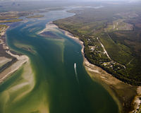 Mouth of a river. Aerial View over the mouth of a river near Caboolture in Queensland with Glasshouse Mountains in the distance Stock Images
