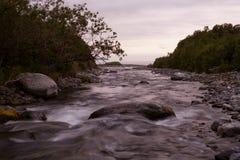 The mouth of the river flows into the sea. Koni peninsula, the Sea of Okhotsk, Hindzha River, Magadan Oblast, Russia Royalty Free Stock Photo