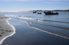 Mouth of the river Maule. Chile. Performing tasks fishermen at the mouth of the river Maule, opposite the town of Constitucion,. Maule Region. Chile Stock Photography