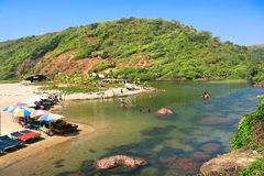 Mouth of river on Querim tropical beach. Near by Arambol (Harmal), Goa, India Royalty Free Stock Photography