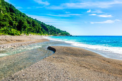 Mouth of the river to the sea on Playa Sana Rafael Beach, Barahona, Dominican Republic Royalty Free Stock Photos