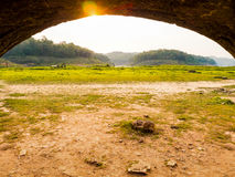 The mouth of the tunnel exit, surrounded by pastures and rocky g Royalty Free Stock Photography