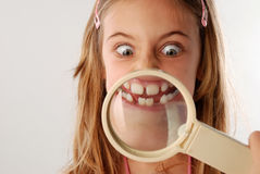 Mouth under magnifying glass Royalty Free Stock Photos