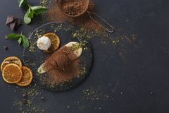 Mouth watering delicious chocolate fondant cake, restaurant serving. Classic French dessert. Chocolate fondant lava cake with custard and vanilla ice cream on stock photos