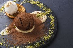 Mouth watering delicious chocolate fondant cake, restaurant serving. Classic French dessert. Warm chocolate fondant lava cake with custard and vanilla ice cream stock photo