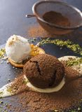 Mouth watering delicious chocolate fondant cake, restaurant serving. Classic French dessert. Warm chocolate fondant lava cake with custard and vanilla ice cream royalty free stock image
