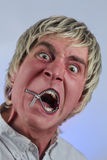 Mouth Zipper. Zipper on mouth silences silly blonde haired man Stock Photos
