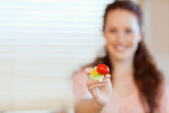 Mouthful of salad being offered by girl Royalty Free Stock Photography