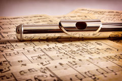 Mouthpiece of flute old handwritten sheet music front view Royalty Free Stock Photo