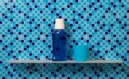 Mouthwash on bath shelf Stock Images