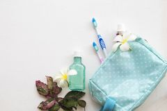 Mouthwash ,toothbrush ,toothpaste health care for oral cavity. In blue bag of lifestyle woman with flower on background white wooden stock photography