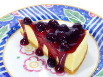 Mouthwatering baked cheesecake with blueberry sauce Royalty Free Stock Photography